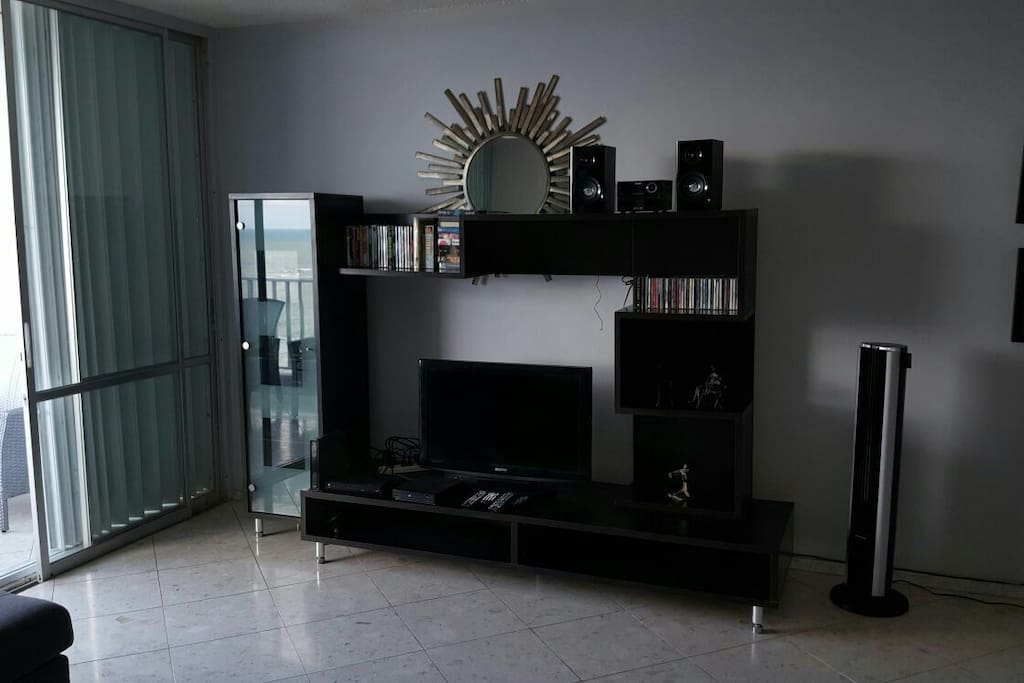 Entertainment Center equipped  with: Flat TV,  WIFI, cable, DVD and CD players with stereo. DVD movies  and CD's with variety music.