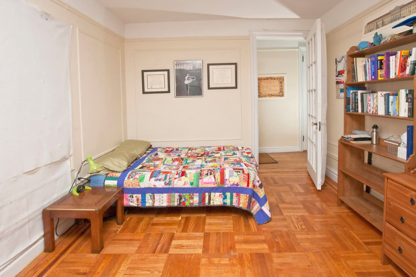 Large bright, private room room with handmade quilts, perfect for two. This is an Airbnb photo taken by a professional photographer.