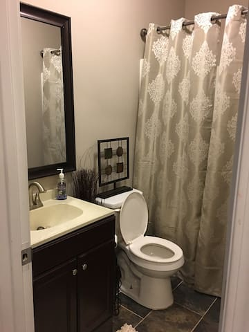 Bathroom is adjacent from bedroom and is shared with owners.