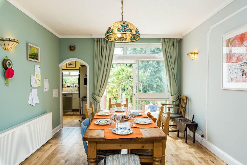 Dining room with adjoining kitchen and easy access to the garden
