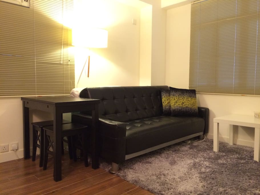 Living room 2/4 - Comfortable sofa. Sofa can be converted to sofa bed if required.