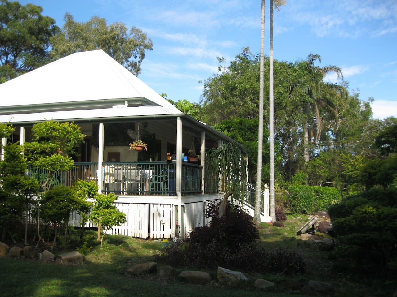 Beautiful traditional Queenslander home, with cool wraparound verandah to sit and relax.