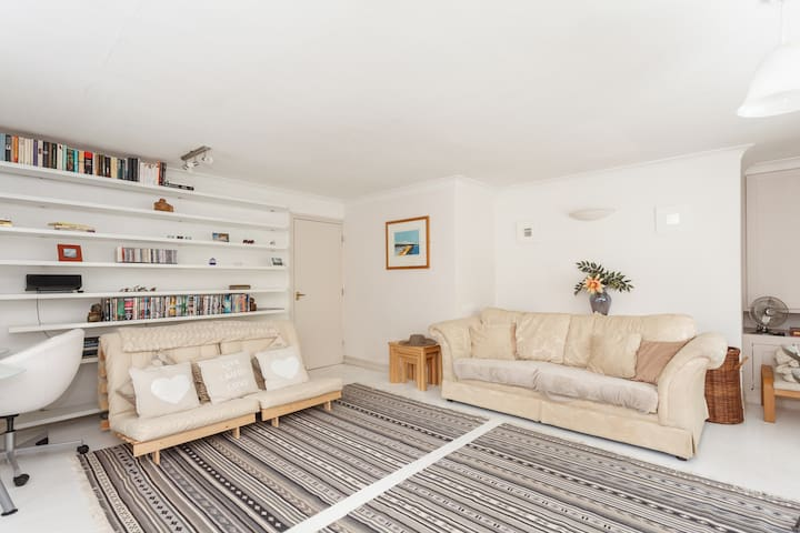 Futons that can be seating in the day and two 3ft single beds in the night! Shelving with  Books, CD's, DVD's.