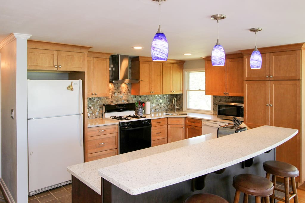 The spacious kitchen has lots of work space, plus a gas range