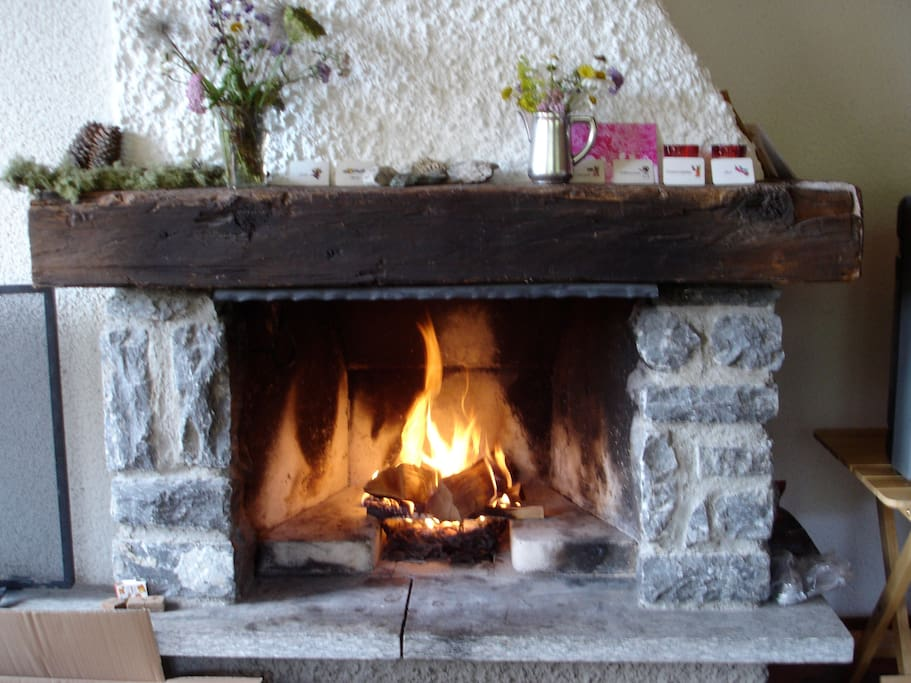 Open fire chimney. The perfect place after a day of skiing in open air.