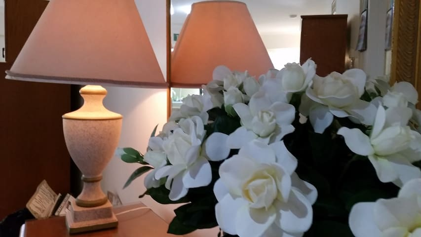 Silk Flowers on Entry Table.