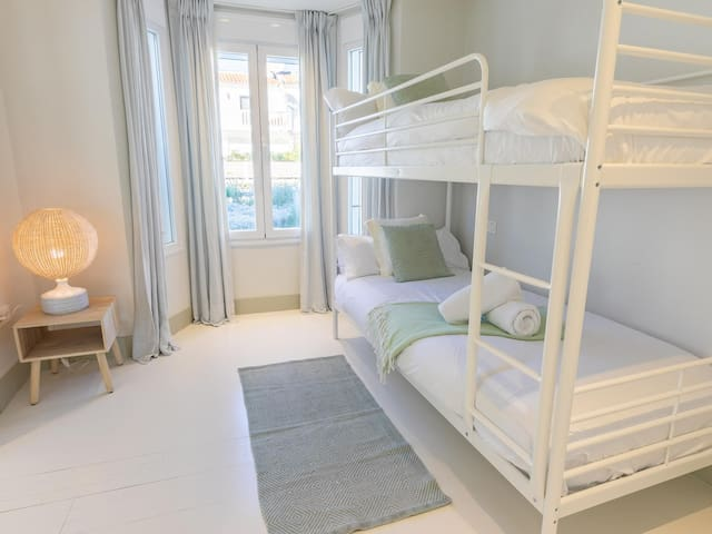 Bedroom #4, with bunk beds and ensuite bathroom