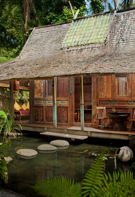 Our House is constructed entirely of teak, and built over a pond