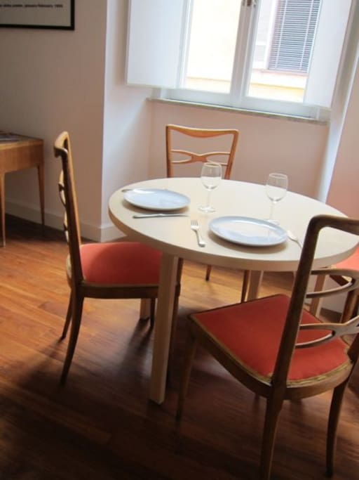 The dining table in the living room.