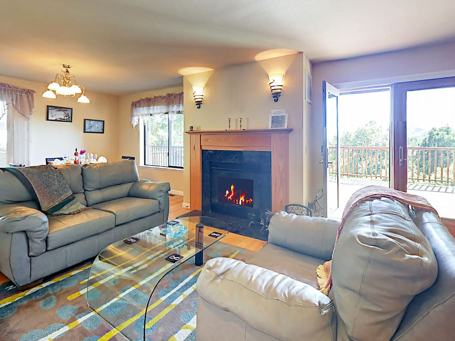 Living area with fireplace and comfortable seating.