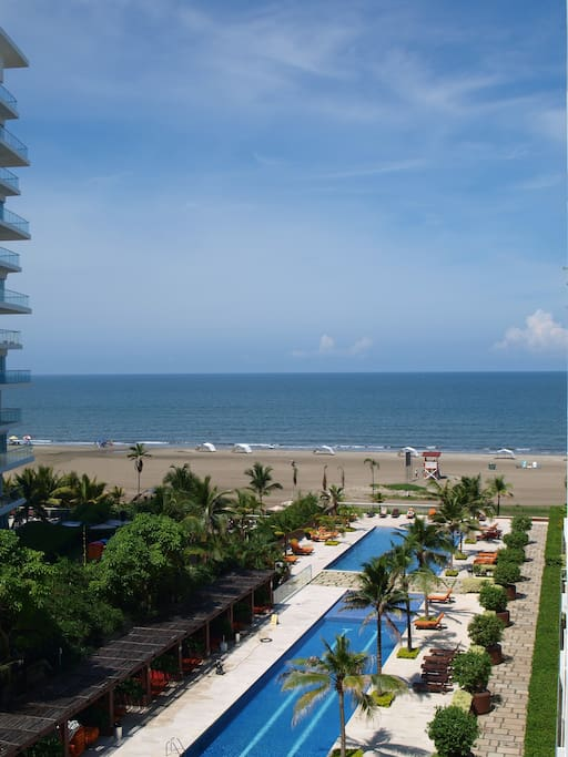 Balcony view, pool area with direct beach access