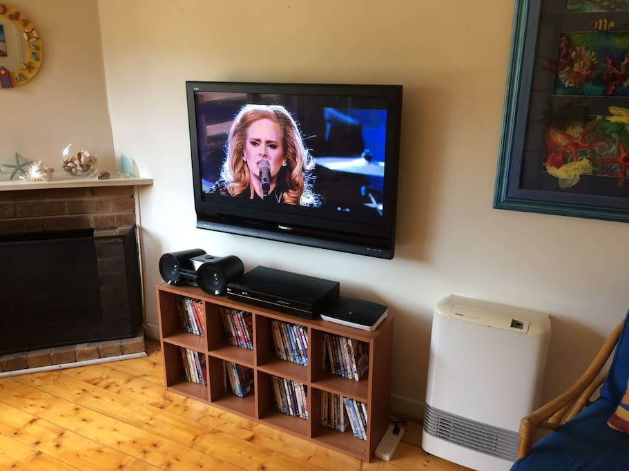 TV, DVD Player, Bluetooth Stereo, Wifi Modem, DVD collection, Open Fireplace and Gas Heater.