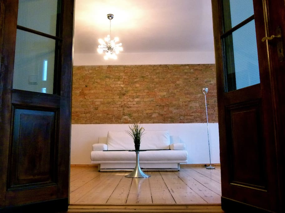 elegant interiors, original hardwood floors, exposed brick wall