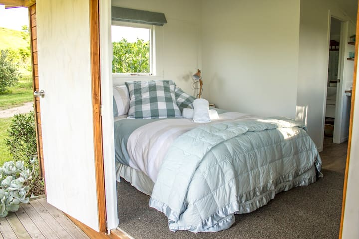 Comfortable, new queen bed with luxurious bedding.