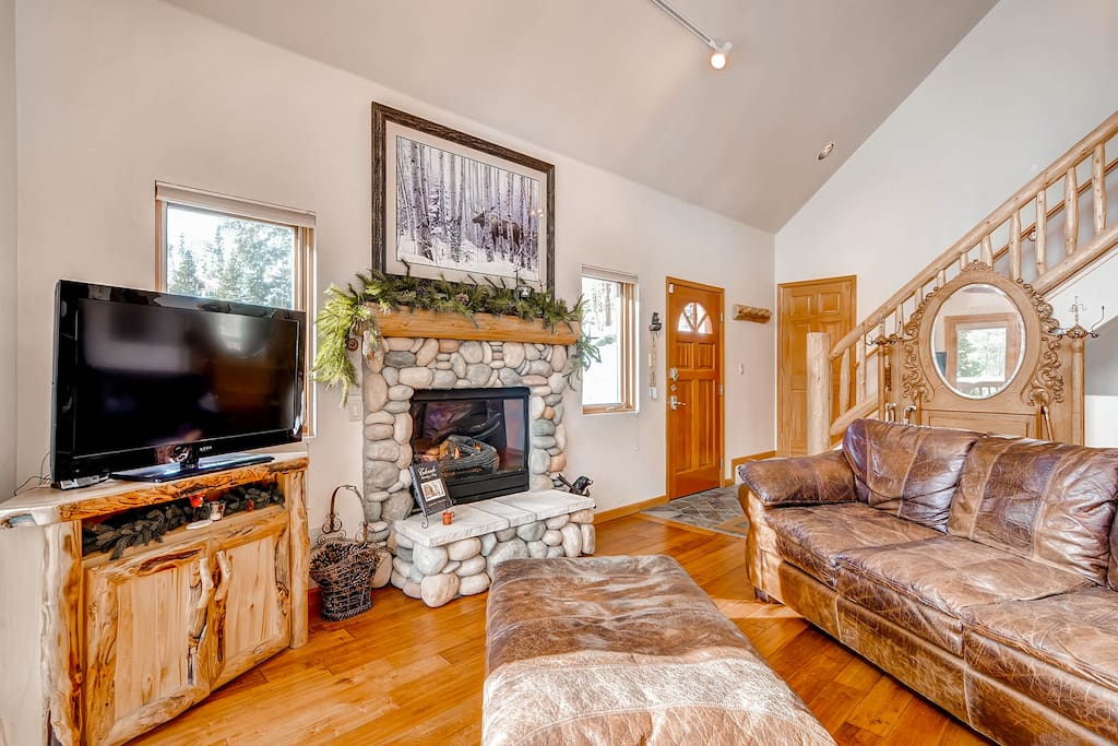 Plenty of space to cozy up by the fire, watch the big game, or gently nod off in the great room.