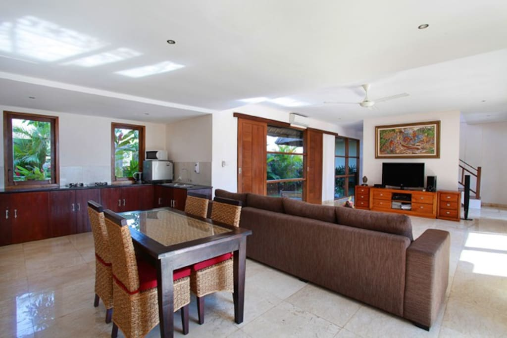 The pool area leads into the guest living room where a private guest kitchen and small dining area are provided.