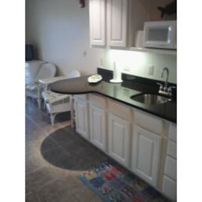 Nice clean new kitchen , counter area-Nicely equipped to serve your needs during your stay!
