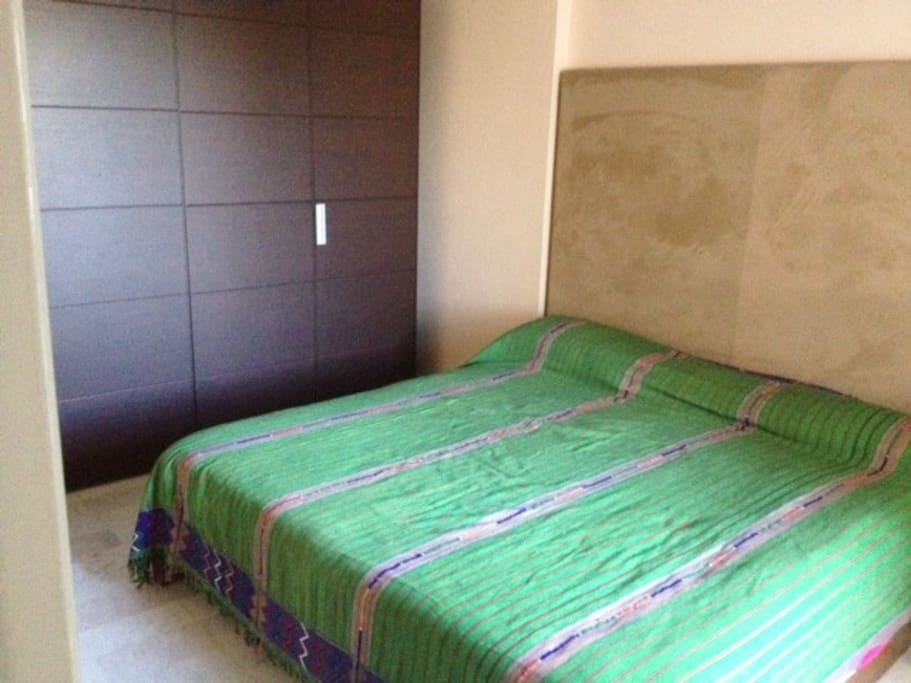 masterbedroom  with large cabinet and Guatemalian bedcover