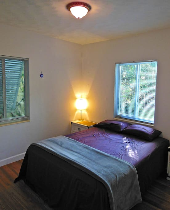 Your room with a queen size bed, drawers, heater, fan, A/C, and 32 inch T.V.