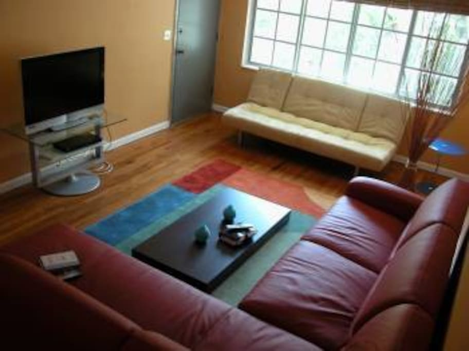 living room with sofa bed and sleeper futon