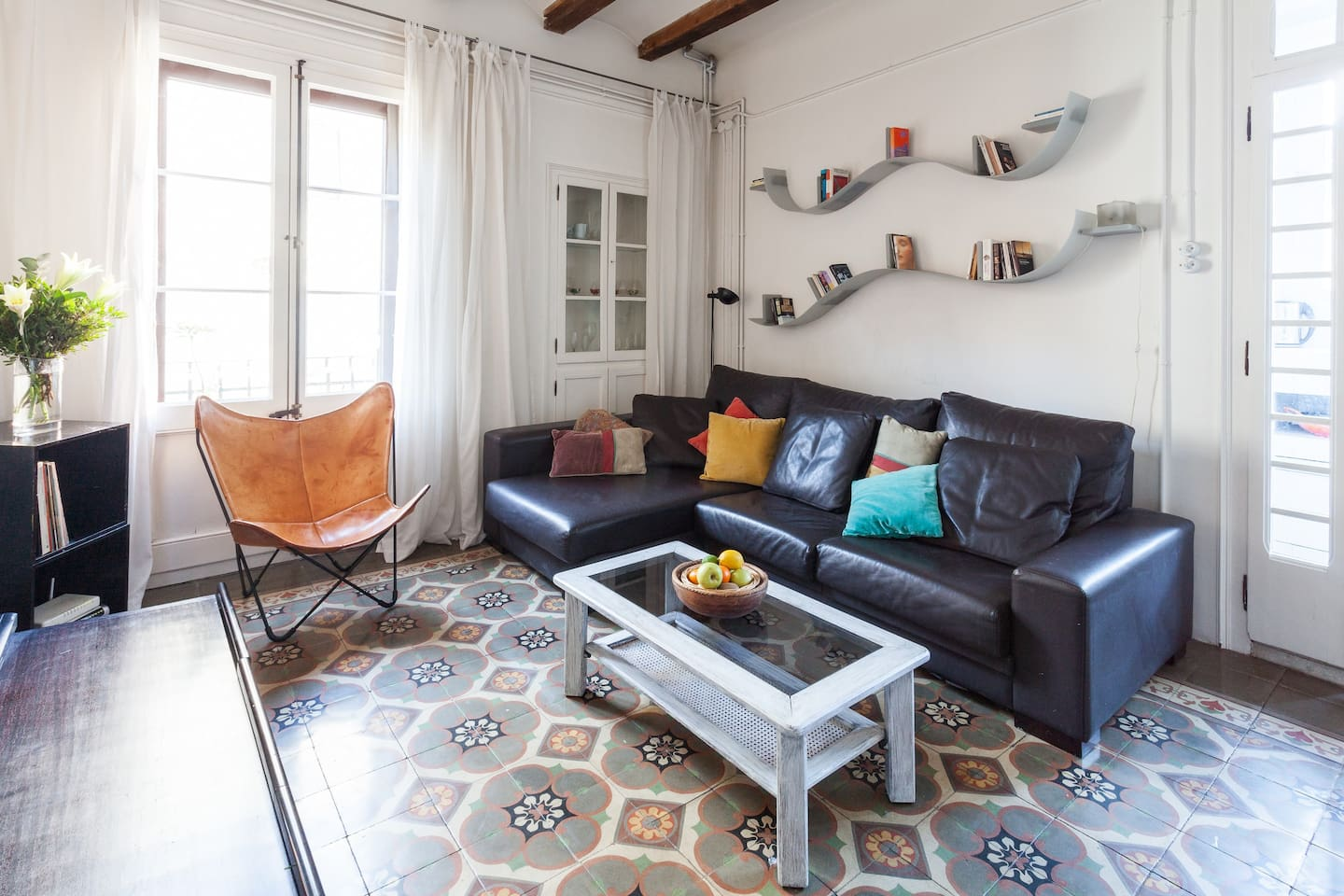 Very bright and beautiful living room with traditional tiled floors and wooden beams