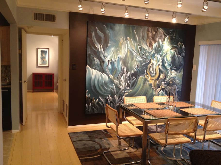 Dining Area with Glass Parson's Table, Brauer Chairs and a Dirk Guidry Original Painting.