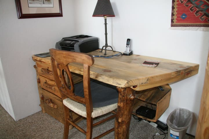 Custom-made desk with printer and wifi in case you have to work