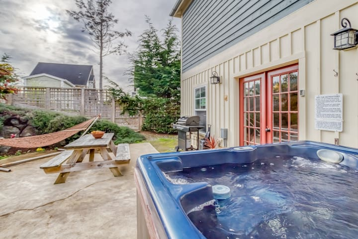 Amenities Galore in This Olivia Beach Cottage with Hot Tub, Carriage House & King Suite!