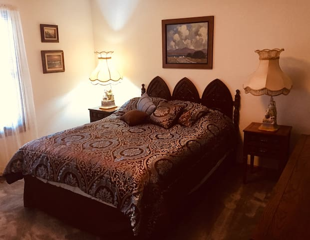 The second private bedroom upstairs has a comfortable double bed and easy access to a full bathroom.
