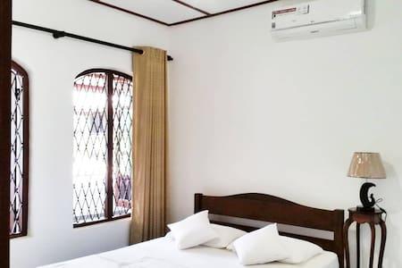 The 28C - A/C Room Queen Bed