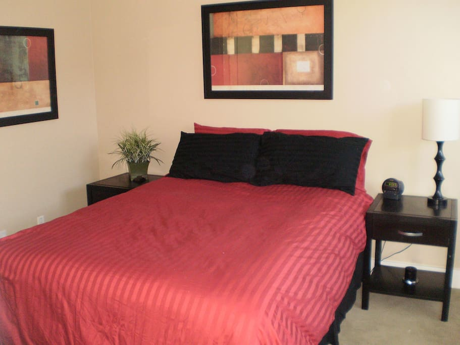 2nd bedroom with queen bed, dresser, and closet