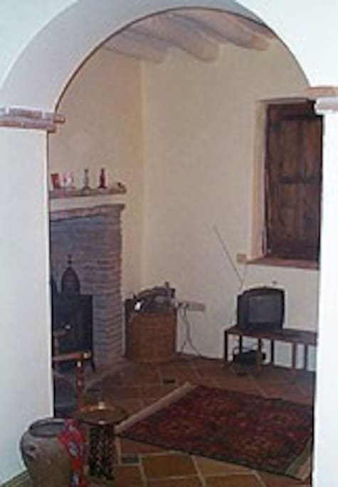 Cosy lounge with wood-burning stove for the winter.