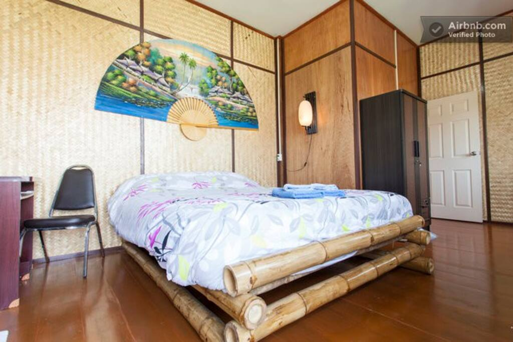 Bamboo decorated room with king-size bed
