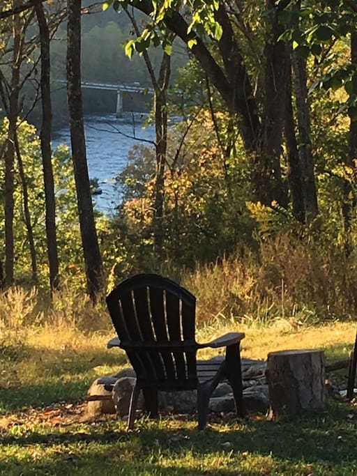 The view of our beautiful French Broad river as seen from your bed in this tent and from your private firepit