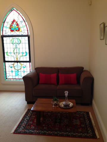 Downstairs Studio with complementary port and private seating
