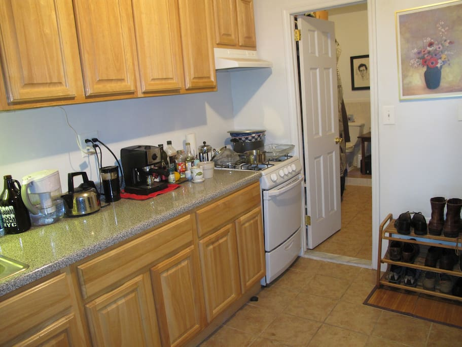 Huge kitchen area for cooking, includes tea kettle and espresso maker.