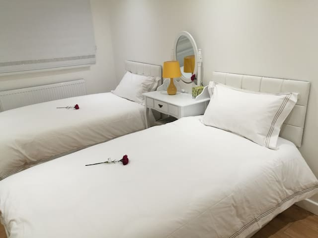 bedroom with two single beds and use a linked superking size bed, dressing table and stool, wardrobe, bedside  tablets.  All rooms with high quality bed linens, towels, single use slippers.