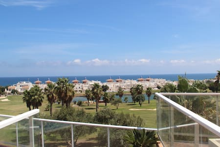New apartment with views of golf course & the sea