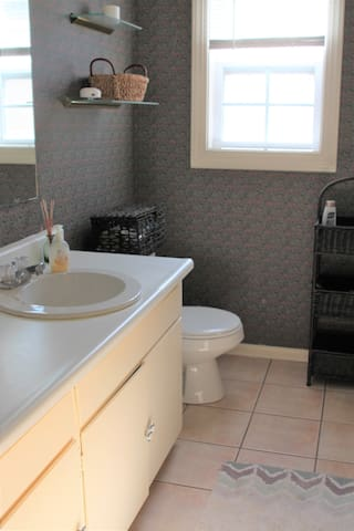 A bright bathroom with a bath tub to get ready for a dinner out on the town.