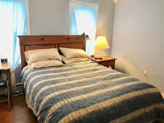 Our guest bed is bright, big and comfortable. We've installed two separately controlled mattress warmers too.