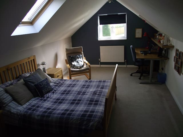 Upstairs double room in a spacious village home.