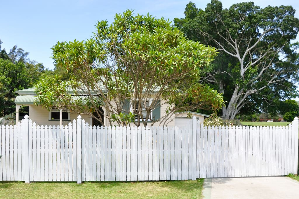 leafy street and mature gardens, fully fenced, beautifully quiet but judst a few minutes walk to town