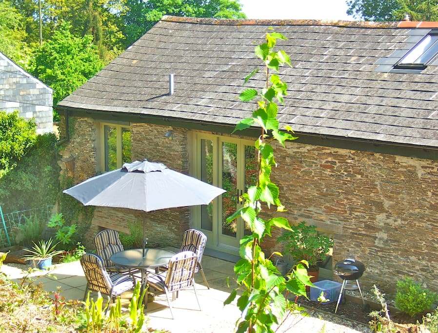 The Barn's secluded garden catches the sun all day long and is perfect for alfresco dining