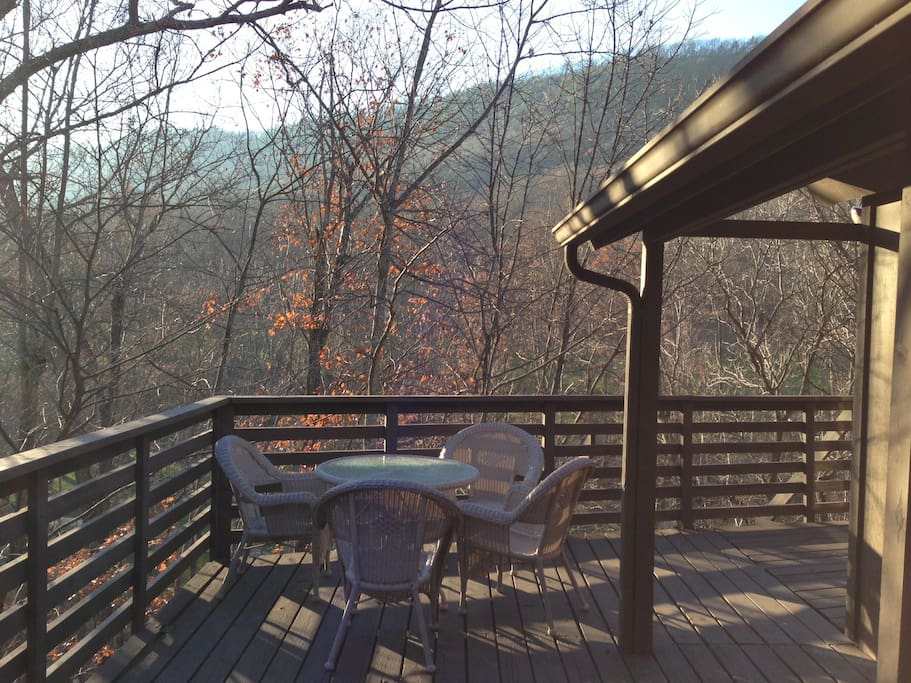 Wrap around deck is a great spot for morning coffee and evening cocktails. We overlook the mountains, woods, creek, and golf course... and have a great winter view of the lighted ski slopes!