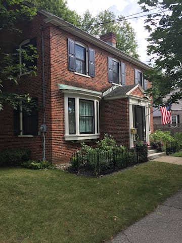 Private room available in a charming NE brick home