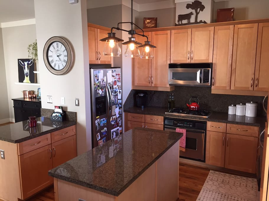 Kitchen with large island, peninsula with seating, and open to dining room!