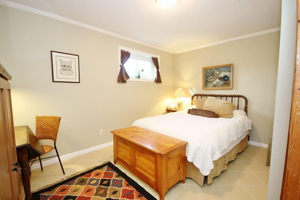 Your quiet bedroom with comfortable queen bed.