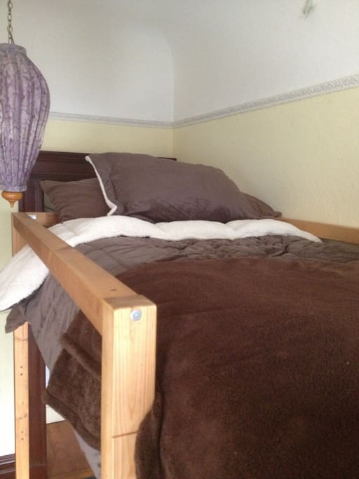 the 2nd bed on the raised loft bed with luxurious bed linens for your comfort.