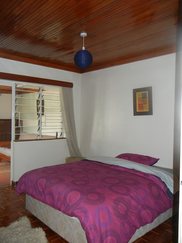Cozy shared bedroom  with adjoining door to second bedroom room , ideal for friends travelling in pairs or couples.