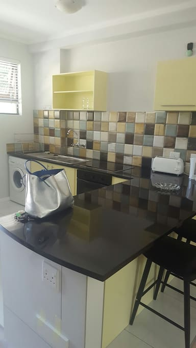 The kitchen is brand new and clean. Includes a stove fridge washing mashine and the necessary.
